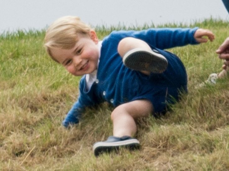 Prince george playing in grass