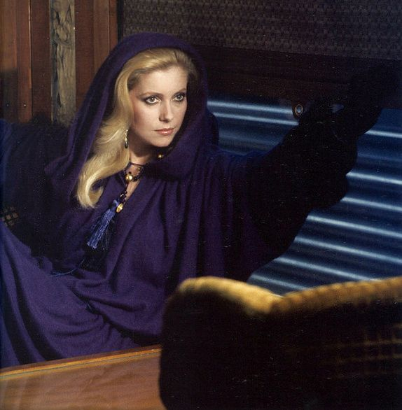 1977 Catherine Deneuve in midnight blue djellaba by Yves Saint Laurent, photo by Helmut Newton, Vogue