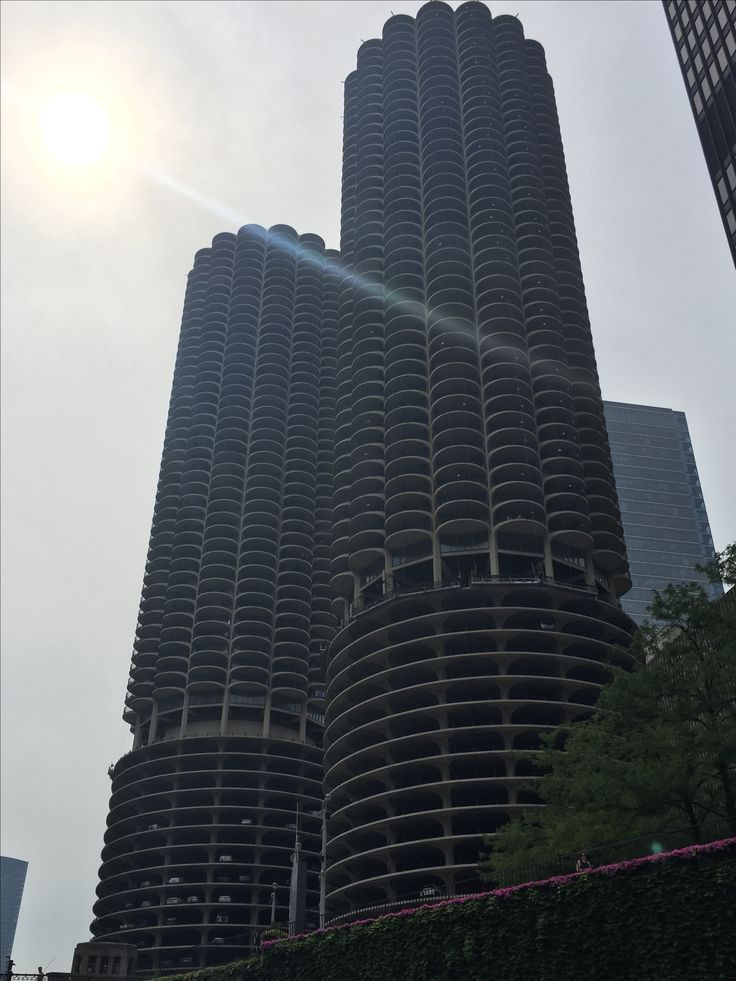 Marina City or the corn cob buildings. These were built as self contained condos where the first floors are parking garages and has a market and places to dock one's boat.