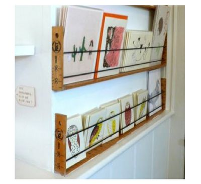 With vintage rulers and metal rods/cables