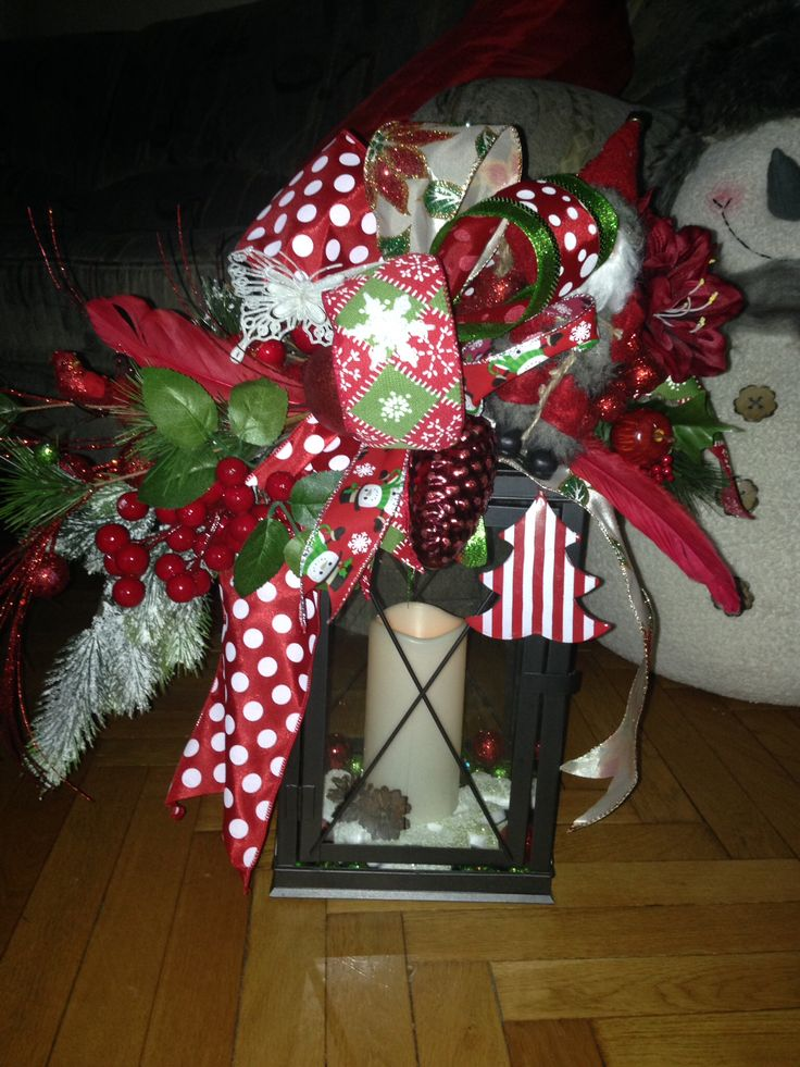 Christmas lantern swag. Christmas lantern decor. Added funky bow, christmas picks and decorations. And a Santa. Inside led candle on timer. More at https://www.facebook.com/Moje-vence-995508700482994/