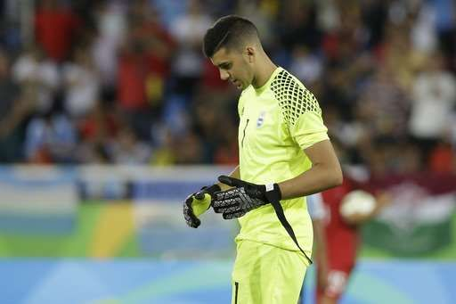 Argentina goalkeeper Geronimo Rulli leaves the field at the end a group D match of the men's Olympic football tournament at the Rio Olympic Stadium between Portugal and Argentina in Rio De Janeiro, Brazil, Thursday, Aug. 4, 2016. Portugal won 2-0. (AP Photo/Leo Correa)