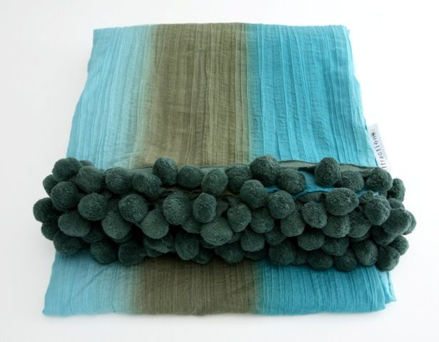 'Urban rhythm' crushed throw with pompom detail - 140 x 240cm. Fits a double, queen or king size bed.