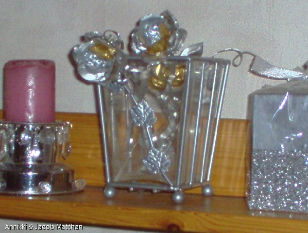 I converted the discarded aluminium candle holds into roses.