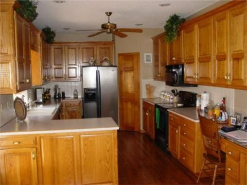 20 best images about kitchens with oak cabinets on for Can you paint non wood kitchen cabinets