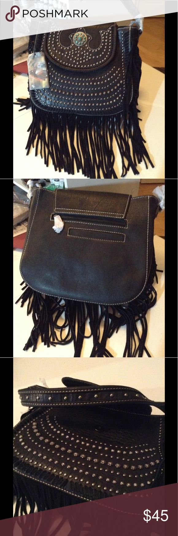 Montana West black Fringe studded purse Gorgeous handbag by Montana west it is approximately 11 inches high 12 inches across and 4 inches wide. It has three compartments on the inside. It is brand-new with all tags and dust cover the MSRP on this bag is $104.99. The style number is MW 197–8291 black I already have this bag in three different colors including black I was giving it as a gift and don't need another black one. It is a wonderful  Quality bag! Montana West Bags Shoulder Bags