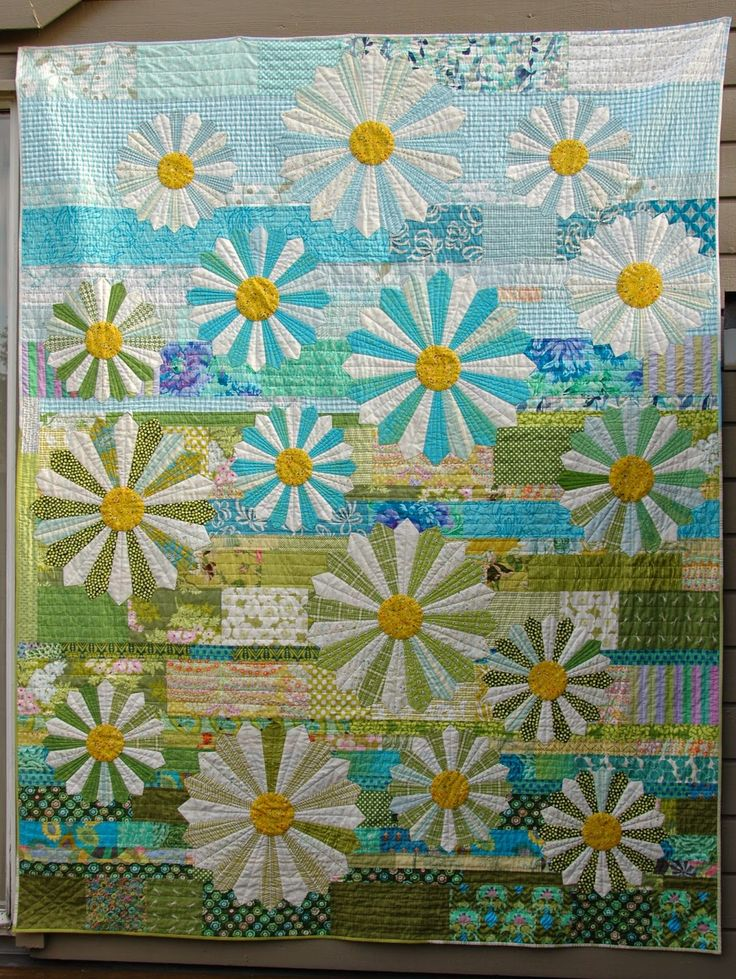 Quilt it: friday finish Hand quilted in the background, Dresdens machine quilted. I love the scrappy background, and I'm fascinated by how the flowers stand out just enough from the background.