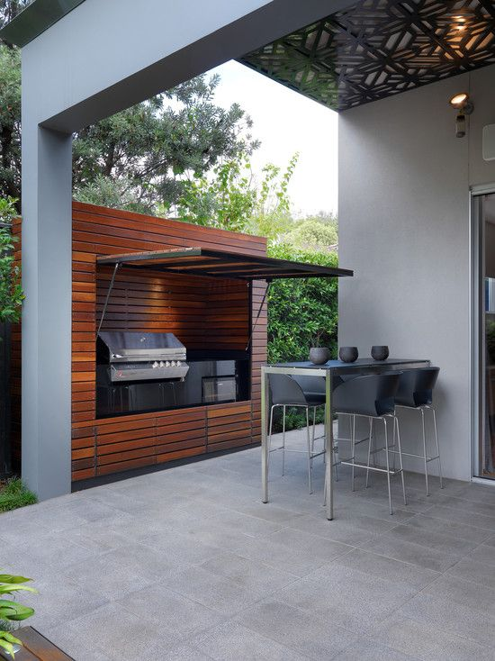 Outdoor barbecue set up with pull down wall to keep dirt out and provide shade while you're cooking. I wouldn't do the inside in wood..... something that would be easy to clean but not burn would be preferable