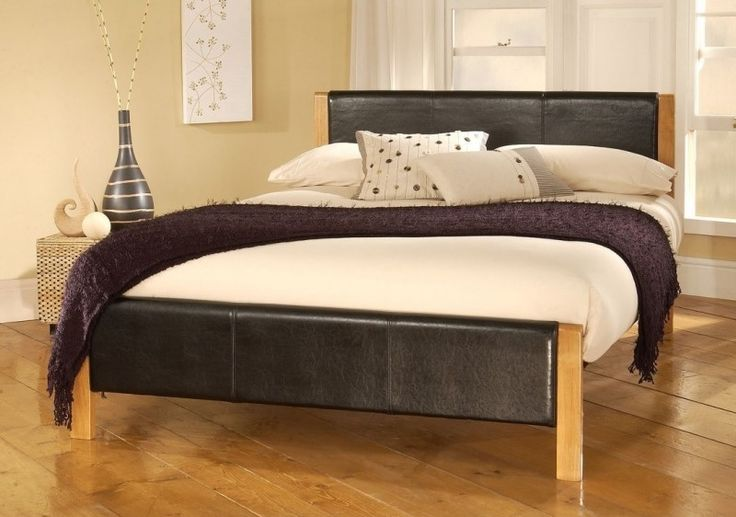 The Mira bed frame is a classy and elegant black faux leather crafted bed frame with oak effect legs.