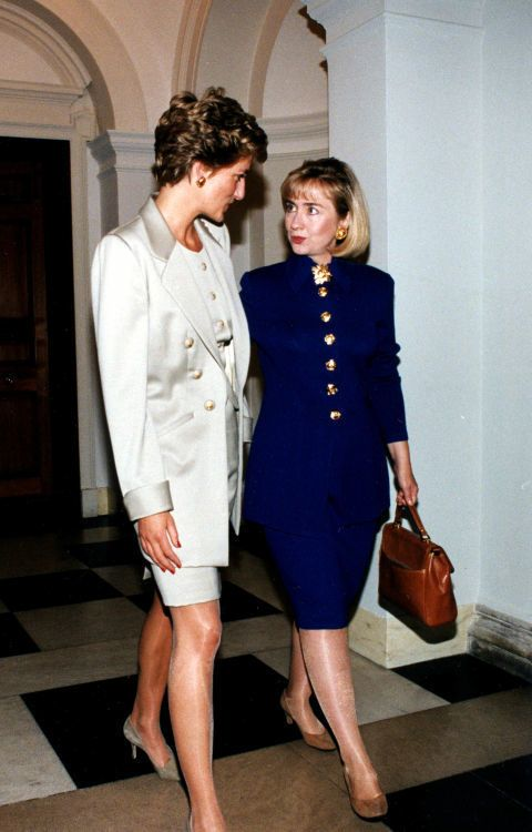 Power suit, check! Big gold buttons, check! Princess Di and Hillary Clinton share a style moment during a luncheon at the British Embassy in 1994.