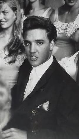 Elvis Presley, a cultural icon of the 20th century, was a singer and actor. Elvis sold over one billion records and made 33 movies.