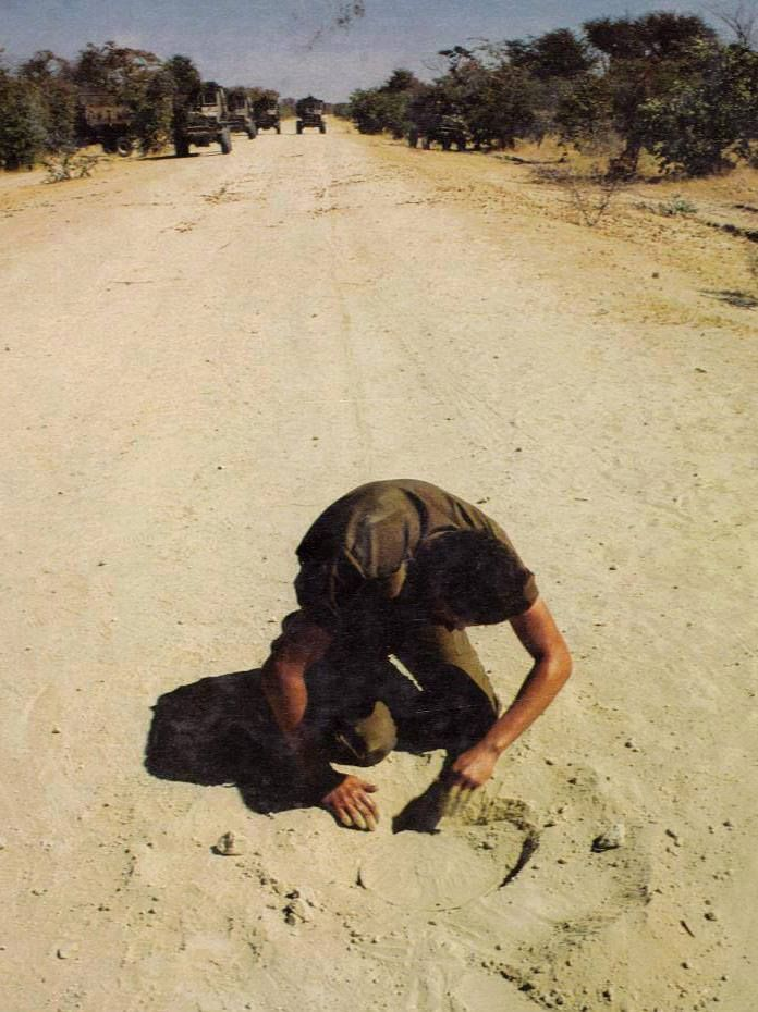 Clearing the road of land mines. South African Border War