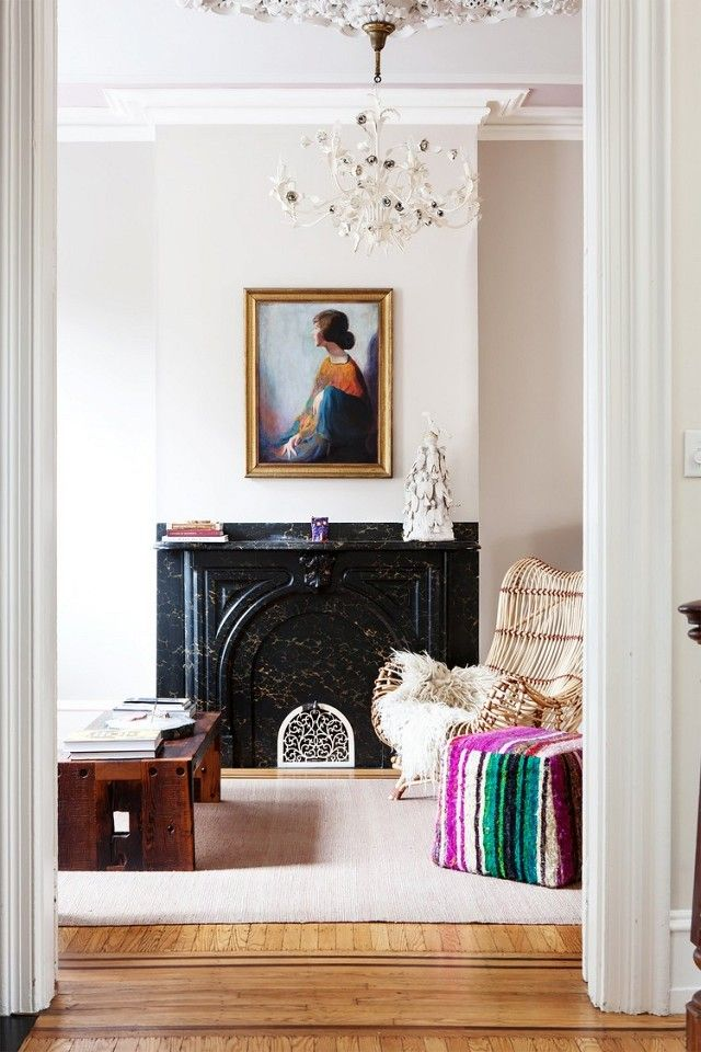 Home with a vintage fireplace, a chandelier, and art as the focal point of the room