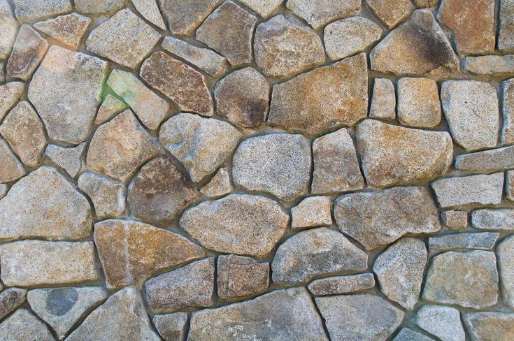 Stone wall this free background texture is of a stone wall the stones are set in - Flaunt your natural stone wall finishes ...