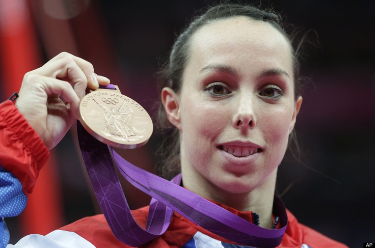 Britain's gymnast Elizabeth Tweddle displays the bronze medal for her performance on the uneven bars during the artistic gymnastics women's apparatus finals at the 2012 Summer Olympics, Monday, Aug. 6, 2012, in London.