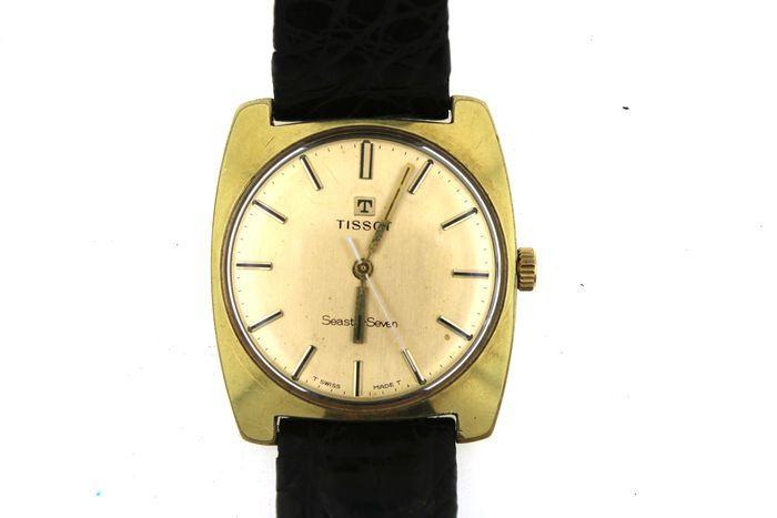 Tissot Seastar zeven - mannen horloge - gemaakt rond 1975 met krokodil leerriem  Koop is een mooie vintage horlogedoor Tissot uit rond ' 75 verguldTissot Seastar-Seven werkt feilloos en is goed bewaard gebleven in de gehelewaarschijnlijk verguld als gevolg van het goud RVS behuizing.De timepiece heeft een bijlage 18 mm band.Echte krokodil band met gespsluiting 21 cmMaten:Breedte 34.5 mm zonder kroonVerzekerde verzending.  EUR 1.00  Meer informatie