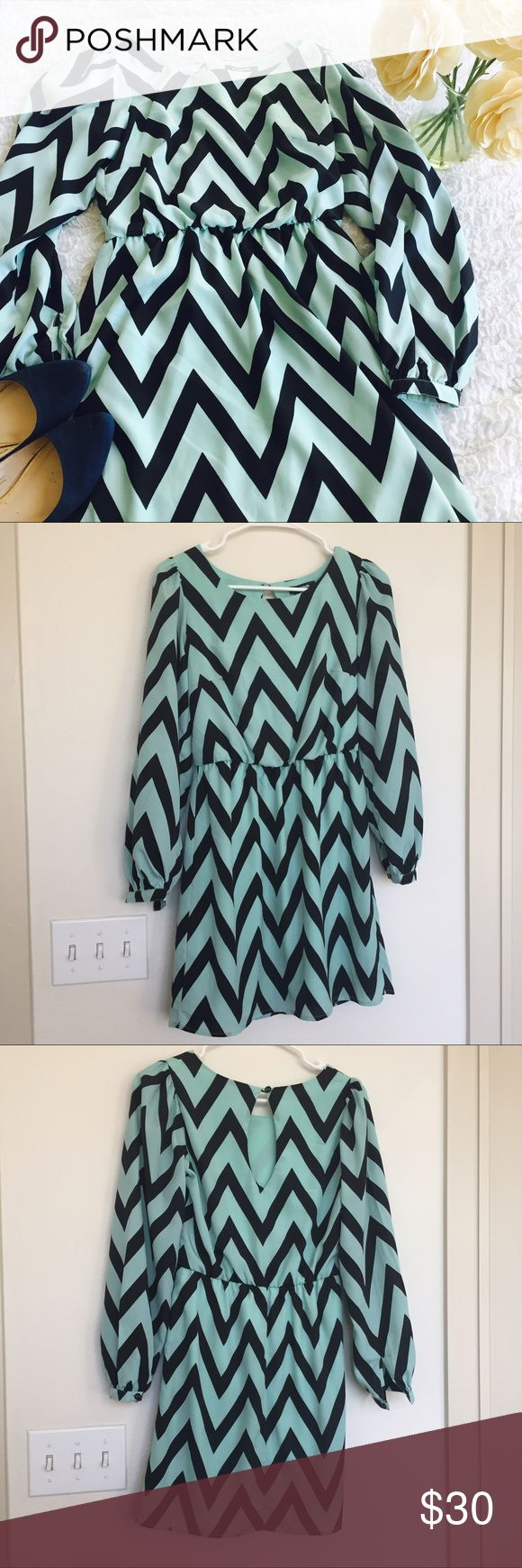 My Michelle Black and Turquoise Chevron Dress This long sleeve My Michelle black and turquoise chevron dress has an elastic waist and a back button closure. 100% polyester My Michelle Dresses Long Sleeve