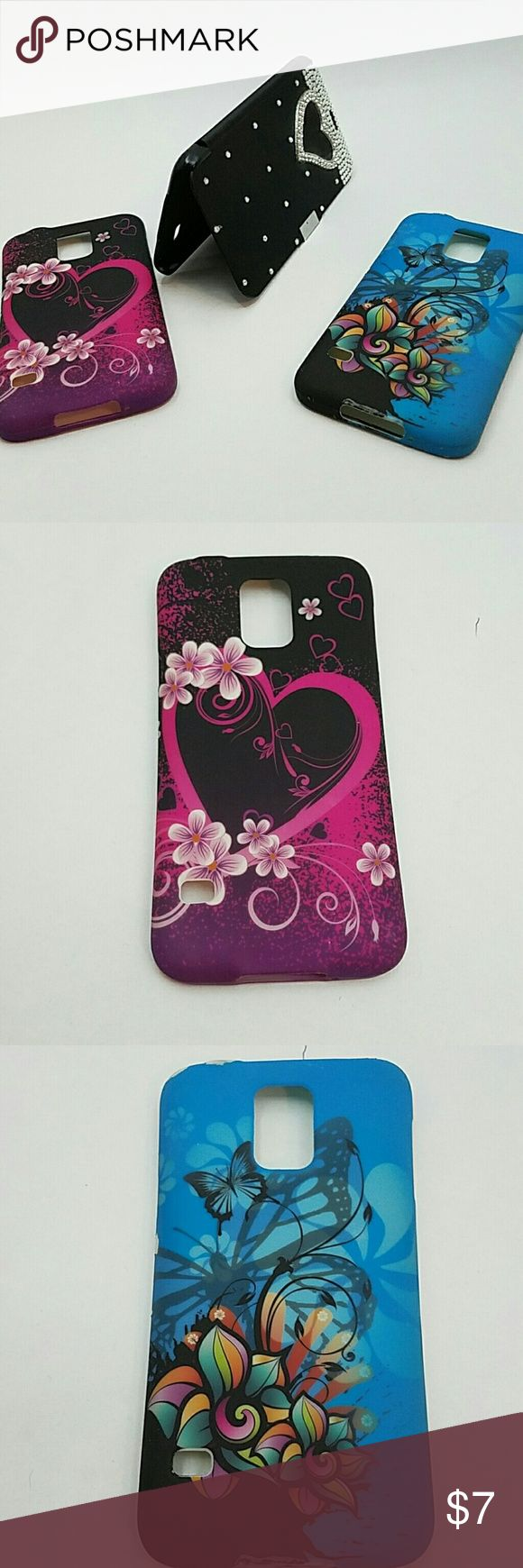 Bundle of 3 galaxy s 5 phone cases 1 pink 1 blue and 1 black Samsung Galaxy S 5 cell phone cases all priced for less than 1! Pink one has a heart and flowers on it, blue one has flowers and butterflies on it and the black one has rhinestones all over it and the shape of a heart in rhinestones and opens up covering your phone completely! Accessories Phone Cases