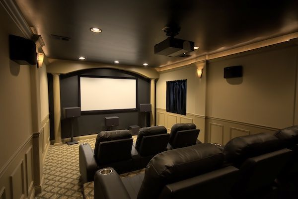 Home theatre ideas. I love how dark the chairs are and the arch over the tv, as well as the dark
