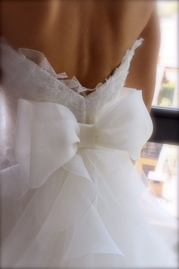 I love the back of this dress. Replace the bow with wings and it'll be perfect!