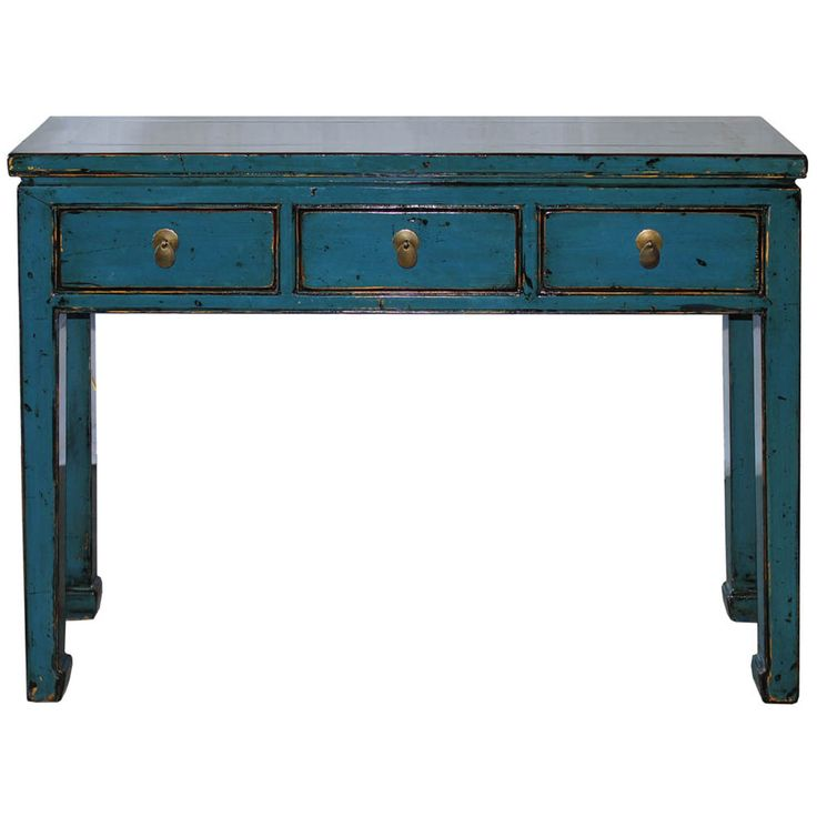 this threedrawer blue lacquer console table is the type of piece you design around
