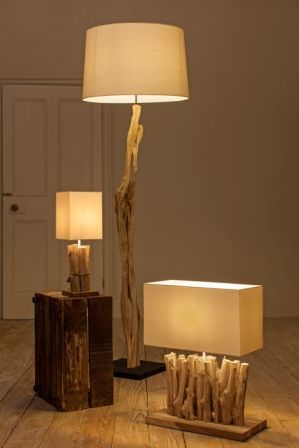Siam and Isra Driftwood Lamps. Ethically sourced reclaimed driftwood lamps supplied with sophisticated cream linen shades.