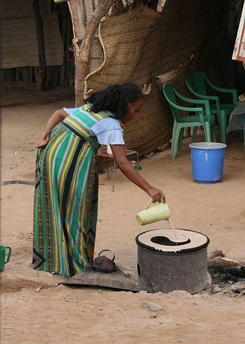 Woman pouring injera