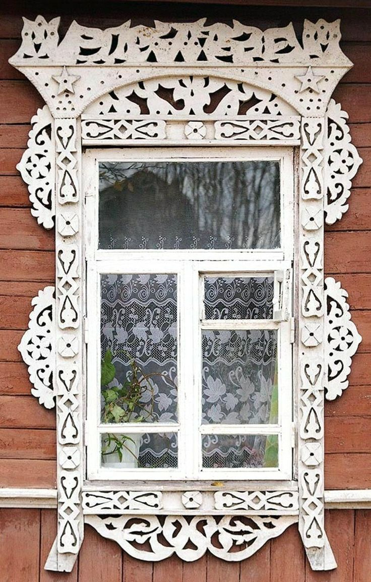 Russian wooden house. Window decorated with openwork carving. #architecture Note the small fortochka window, a small window that opens for ventilation.