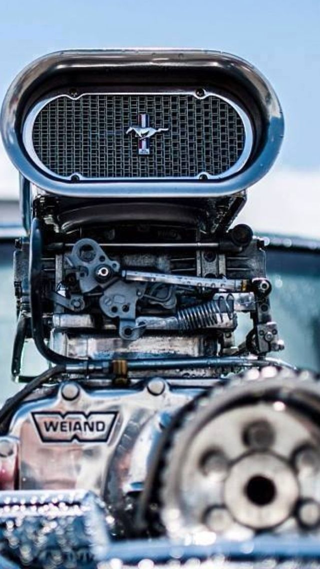 Best Muscle Car supercharged Ford Mustang. Great shot of the engine. The lighting shows the metal off very well! They must have boosted the blue. #musclecars