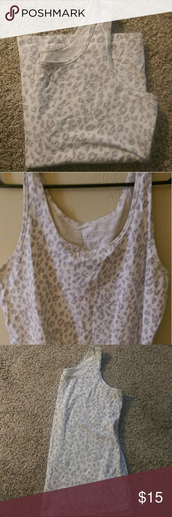 Plus Size 20-22 Animal Print Cami Great condition, plus size camisole. Maurices size 2 (20-22). Creamy white color with grey cheetah animal print. No trips, stains, tears. Still can tell its been worn a few times because of texture. Smoke free Maurices Tops Camisoles