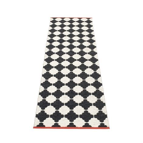 Woven plastic rug from Pappelina. Made in Sweden.