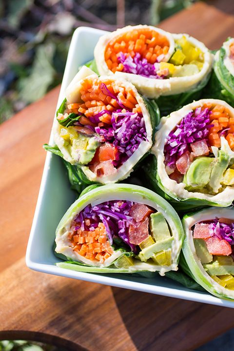 INGREDIENTS BY SAPUTO | This colourful vegetarian wrap recipe is sure to be the star of your next picnic at the park! Roll up carrots, avocados, peppers and tomatoes in a leaf of red cabbage and add some hummus and Saputo Havarti cheese for a healthy lunch idea. Who knew eating your vegetables could be so much fun?