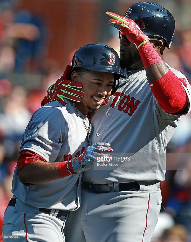 The Red Sox Mookie Betts is all smiles as he gets a hug and a pat on... News Photo | Getty Images