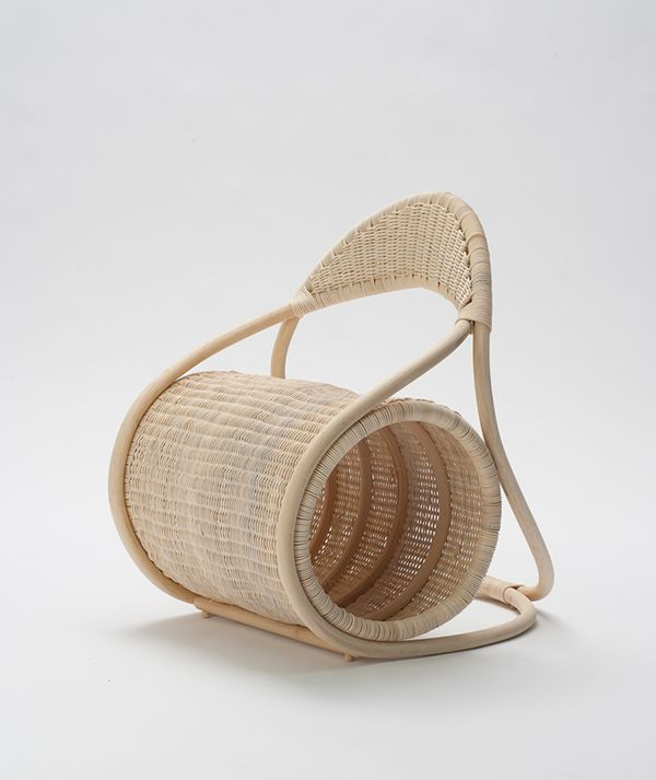 Bobbin ChairEmbracing the characteristics of the material rattan, this chair offers a flexible seat and backrest.​ The continuous curves create a frame for the cylindrical seat, and keeps the construction ​simple and the idiom formalistic.