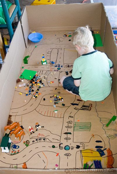 A town for Lego toys to populate. | 31 Things You Can Make With A Cardboard Box That Will Blow Your Kids' Minds