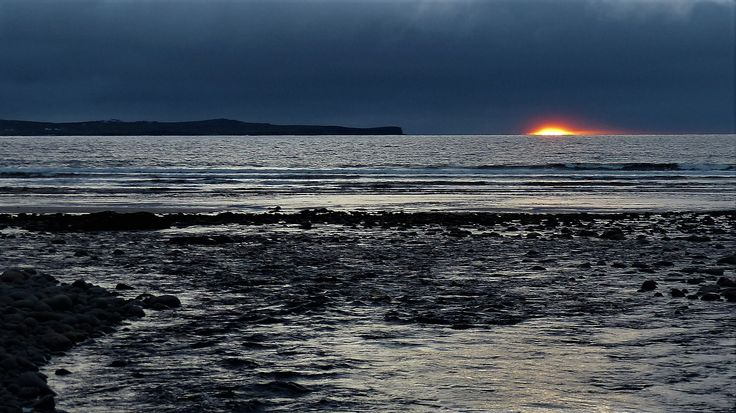 Co. Clare: sunset at Clogher Strand.