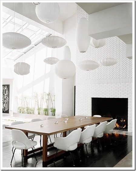 Contrasting black and white combined with whimsical lanterns and natural wood creates an airy Japanese dining space   Indulgy