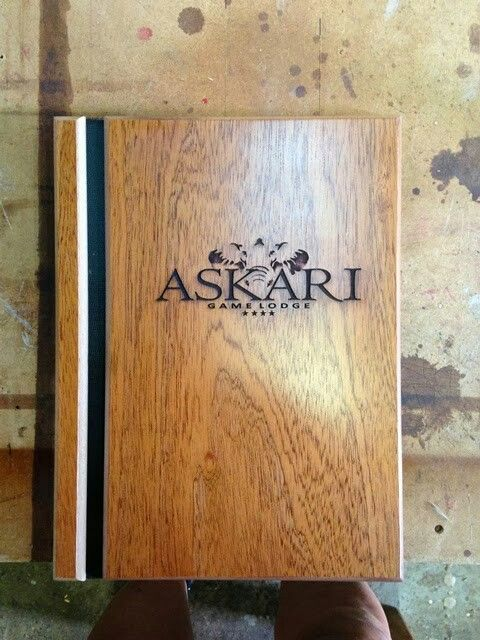 Solid wooden menu cover with logo lazered on front cover.
