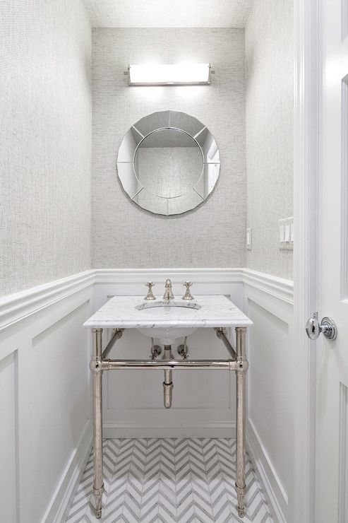 The round mirror in this bathroom is a really exquisite design touch! We love how it goes with the herringbone tile and the chrome hardware. From Clean Design Partners