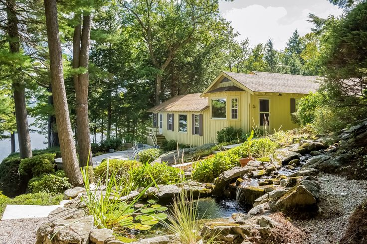 Nothing's more relaxing than reading by the Koi pond while listening to the sound of stream from the waterfall. #lakeliferealty #ontherocks #Alton #NH