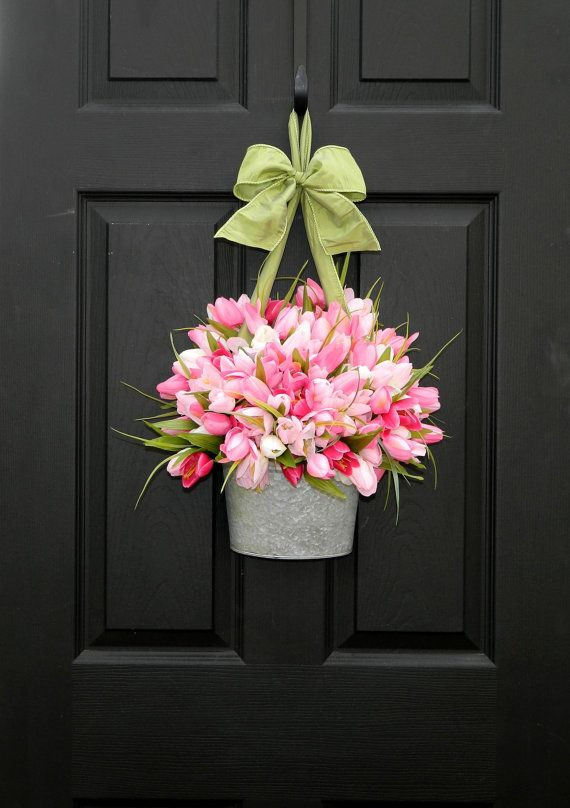 Such a pretty idea for the door in Spring. I especially love the bow. Would just want to put felt on the back so the door wouldn't get scratched.