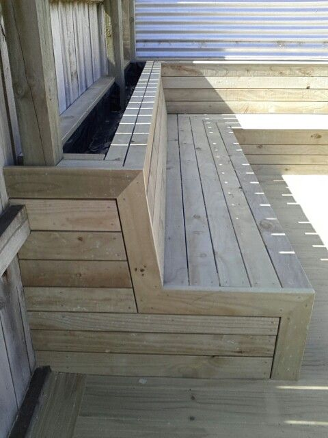 Seating with planter box right at the bottom of the porch