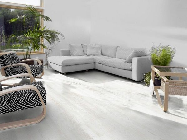 laminate plank optic white bright living room houseplants gray corner sofa