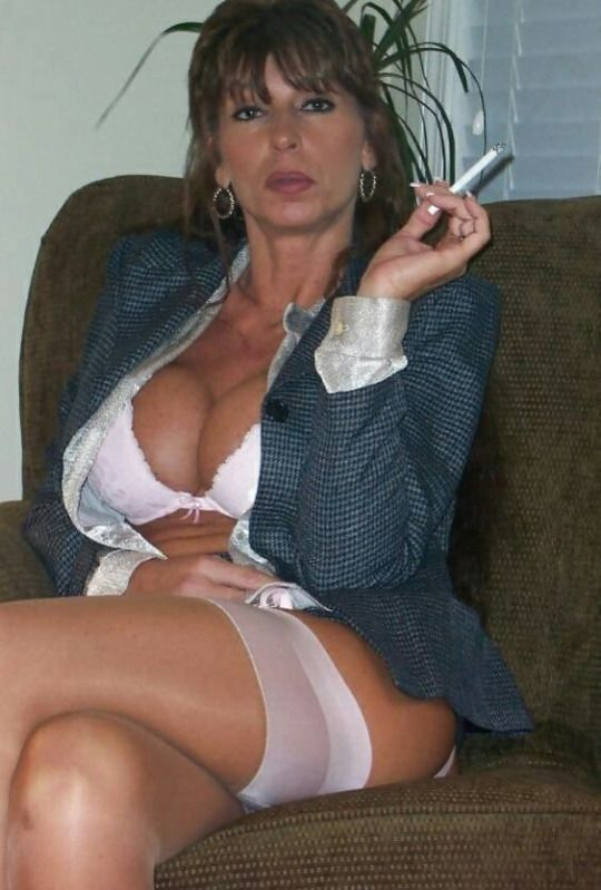 Busty mom smoking cigarette and sucking cock 1