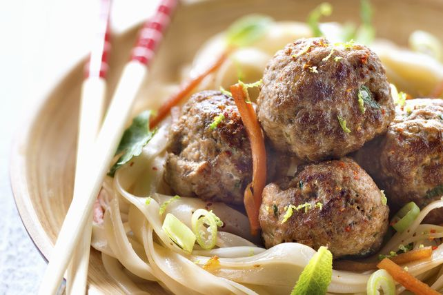 Asian sesame dressing does double duty here – once to flavour chicken meatballs and again to dress rice noodles. Serve the two together for a perfect pairing.