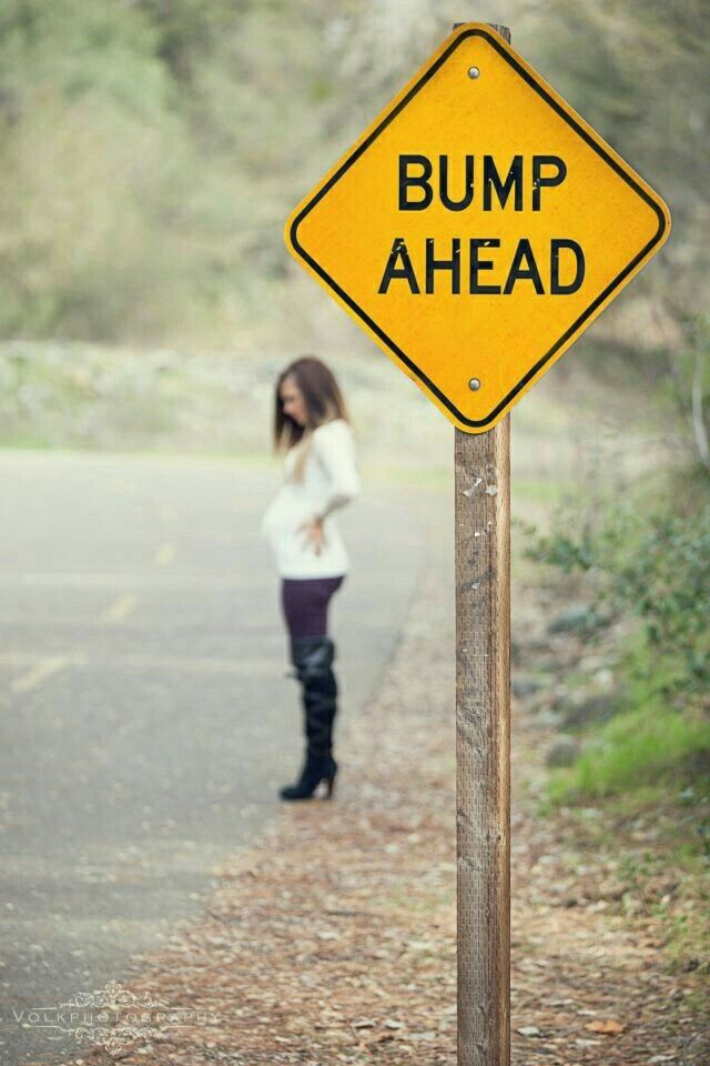 Love this use of signs for funny pregnancy shoot