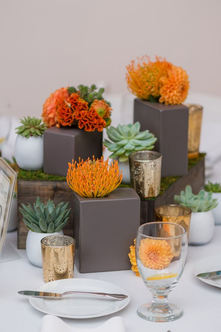 Modern floral centerpieces https theknot real