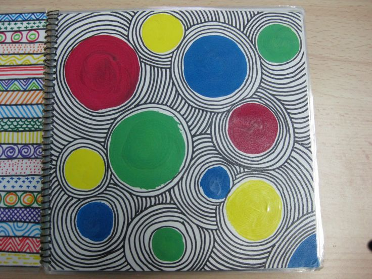 Cut out circles and have students choose color groups. Create a background with pattern in black sharpie.