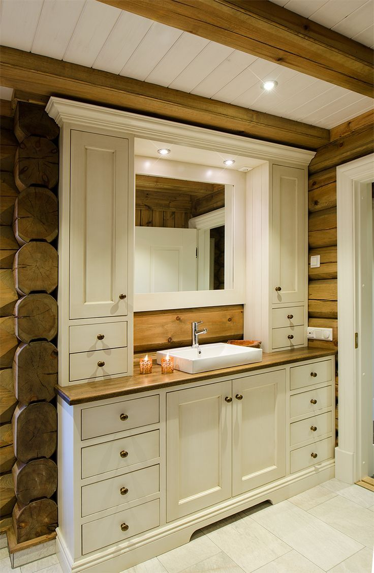 Light bathroom furniture in log cabin, tailored to…