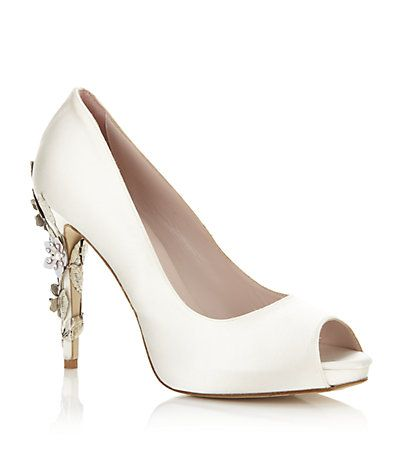 Inspired by a floral theme Harriet Wilde's ivory satin Sakura peep toe pump features an elegant heel with ornate silver leaves and delicate pink cherry blossom cascading down the heel; a unique design that will make your wedding day extra special.